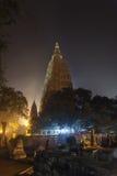 Mahabodhi Temple and Bodhi-tree in night-time lighting. Night illumination of a Bodkhi-tree near base of Mahabodhi Temple, on the place where Buddha Shakyamuni Stock Image