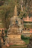 A plain temples at Bodh Gaya. The Mahabodhi Temple literally: `Great Awakening Temple`, a UNESCO World Heritage Site, is an ancient, but much rebuilt and Royalty Free Stock Photography