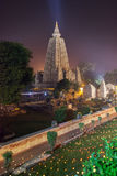 Mahabodhi Temple in night-time lighting. The place of an enlightenment of Buddha, Mahabodhi Temple in beams of night illumination and in festive decoration in Stock Photos