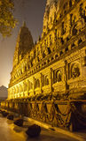 Mahabodhi Temple in night-time lighting. The place of an enlightenment of Buddha, Mahabodhi Temple and stupas in beams of night illumination and in festive Royalty Free Stock Photos