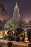 Mahabodhi Temple in night-time lighting. The place of an enlightenment of Buddha, Mahabodhi Temple and stupas in beams of night illumination and in festive Royalty Free Stock Image