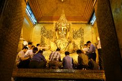 People at worship in Mahamuni Buddha Temple Golden royalty free stock photography