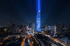 Mahanakhon lights up in Bangkok Downtown, Thailand. Financial district and business area. Smart urban city technology. Skyscraper stock image