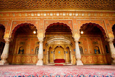Maharaja's resting room with arches in gold patterns Stock Image