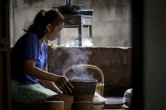 MAHASARAKHAM THAILAND - JULY8,2017 : thai north eastern woman pr. Epare steaming sticky rice from bamboo basket for all day meal ,sticky rice most faverite and royalty free stock photography