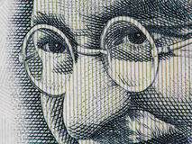 Mahatma Gandhi face on indian 100 rupee banknote extreme macro, Stock Image