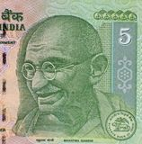 Mahatma Gandhi. On 5 rupees banknote from India Stock Photos