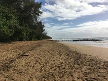 Mahaulepu beach in Kauai, Hawaii on a cloudy day stock photography