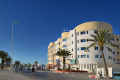 Mahdija - panorama. One of the busiest streets in Tunisian coastal tourist city Mahdi with modern masonry Stock Photography