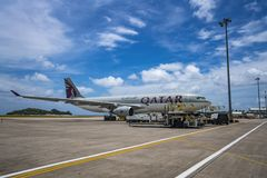 MAHE, SEYCHELLES - OCTOBER 4, 2018: Qatar Airways Plane at Mahe airport in Seychelles. Qatar Airways is included in the list of royalty free stock photo