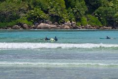 MAHE, SEYCHELLES - SEPTEMBER 25, 2018: Unidentified man surfing on a large wave on island Mahe on the coast of Indian ocean - is. The best surf paradise in royalty free stock photography