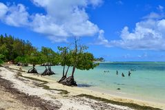 Idyllic tropical sea in sunny day. Mahebourg, Mauritius - Jan 7, 2017. People enjoy on the beach in Mahebourg, Mauritius. Mauritius is a major tourist royalty free stock photography