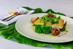 Mahi-mahi fillet and clams with broccoli and fresh herbs royalty free stock image