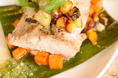 Mahi with pineapple salsa on banana leaf Stock Image