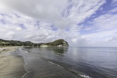 Mahia Beach Morning. Glassy calm conditions in the morning at Mahia Beach, which is a popular vacation spot at the northern end of Hawkes Bay NZL stock images