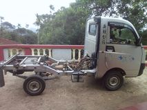 Mahindra Maxximo συν το μίνι φορτηγό στοκ φωτογραφία με δικαίωμα ελεύθερης χρήσης