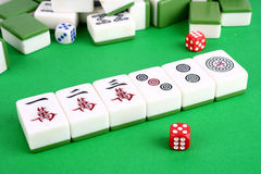 Mahjong. Tiles aligned and two dices royalty free stock photography