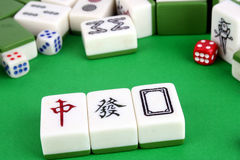 Mahjong. Tiles aligned and two dices stock photography