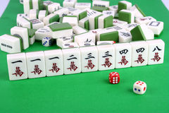 Mahjong. Tiles aligned and two dices stock images