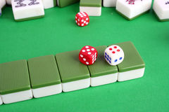 Mahjong. Tiles aligned and two dices Stock Photo
