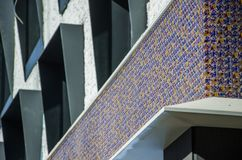 Mahjong dice wall. The facade of the building is a wall decorated with mahjong dice tiles stock photos