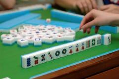 Mahjong game. People playing mahjong on a table stock image
