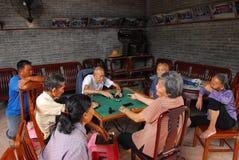 Mahjong playing. People playing mahjong game at living room Stock Image