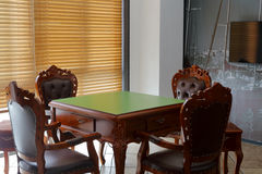 Mahjong table. In the chess room with venetian blinds royalty free stock photography