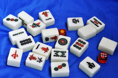 Mahjong tiles on blue background royalty free stock photography