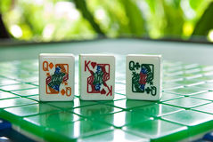 Mahjong tiles of the King of hearts with two queens Stock Images