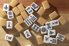 Mahjong tiles on wood table. Background royalty free stock photo