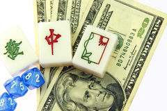 Mahjong for US dollars. Mahjong tiles of the red dragon, green prosperity & the window over US dollars stock image