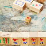 Mahjong wood tiles close up and playing field Stock Photo