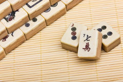 Mahjongg on bamboo mat background Royalty Free Stock Photography
