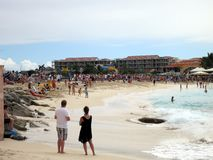 Maho Beach and Airport runway. Crowds waiting for KLM `Asia`, Boeing 747 approach, Maho Beach, Sint Maarten Royalty Free Stock Photography
