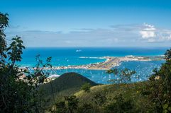 Maho-Beach and Princess Juliana Airport, St. Maarten. View from the hilly center of the island on the famous Maho-Beach with Princess Juliana Airport, St royalty free stock images