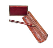 Mahogany ball pen in an opened wooden case stock photo
