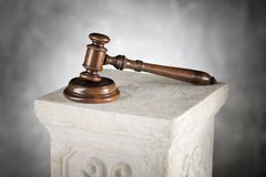 Mahogany Gavel. And sound block on a plaster column Stock Images