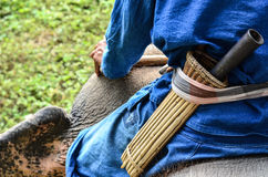 A Mahout with a pocketknife Royalty Free Stock Photography