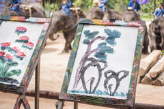 Mahout train elephant drawing a picture. Daily elephant show at The Thai Elephant Conservation Center, Mahout train elephant drawing a picture. Lampang royalty free stock photo