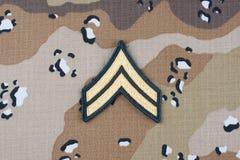 12 mai 2018 Correction luxuriante de caporal de l'ARMÉE AMÉRICAINE sur le fond uniforme de camouflage de désert photo libre de droits