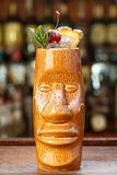 Mai tai cocktail in tiki glass close up stock image