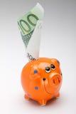 Maiale arancione con soldi Immagini Stock Libere da Diritti