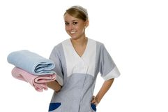 Maid. Young maid with bath towels Royalty Free Stock Photography