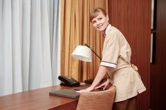 Maid arranging hotel stationery Royalty Free Stock Image