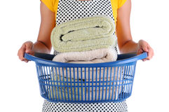 Maid With Basket of Towels Stock Image