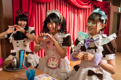 Maid Cafe in Akihabara, Tokyo, Japan. Chimu and her friends do a chant while making a Magic Shaker drink @Home a maid cafe in Tokyo`s Akihabara district Royalty Free Stock Images
