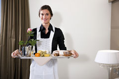 Maid Carrying Breakfast Tray. Happy Maid Carrying Breakfast Tray Stock Images