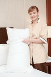 Maid changes bedclothes in hotel Royalty Free Stock Images