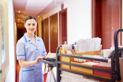 Maid with clean bedclothes Royalty Free Stock Image